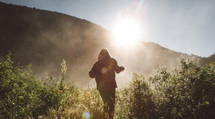 woman running sun